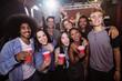 Portrait of cheerful friends at nightclub