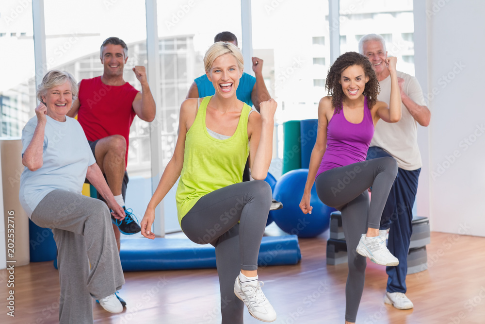 Fototapety, obrazy: People doing power fitness exercise at fitness studio