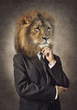 Lion in a suit. Man with a head of an lion. Concept graphic in vintage style. - 202535518