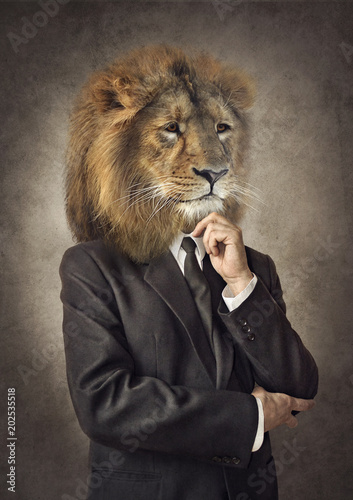Fotobehang Leeuw Lion in a suit. Man with a head of an lion. Concept graphic in vintage style.