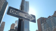 CLOSE UP: One way street signs at intersection on sunny day in New York City