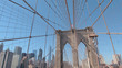 CLOSE UP: Iconic Brooklyn Bridge overlooking New York downtown business district