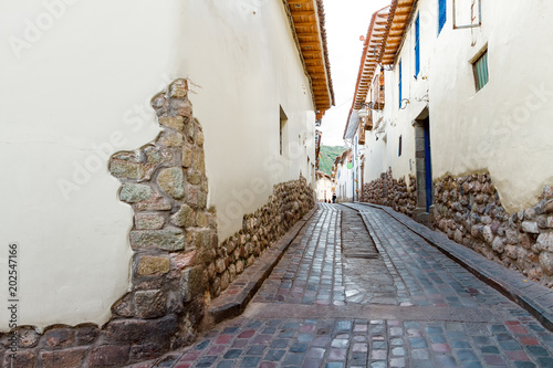 Photo Stands South America Country Narrow alley of Cusco (Peru) with cobblestone
