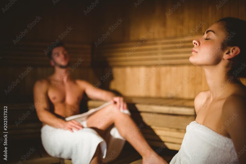 Fototapeta Happy couple enjoying the sauna together