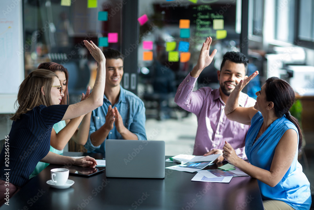 Fototapety, obrazy: Team of businesspeople giving high five