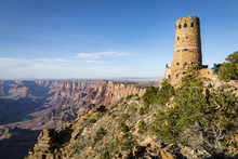 View Over The South Rim Of Grand Canyon National Park In Arizona Showing Clouds And Shadows Across The Landscape And The Indian Watch Tower