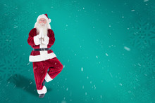 Father Christmas Doing Some Yoga Against Green Snowflake Background