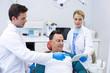 Dentists showing dental report on digital tablet
