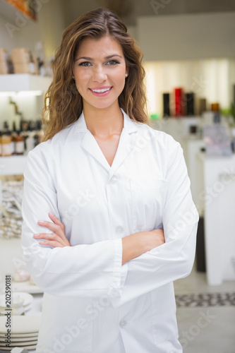 Portrait of smiling beautician with arms crossed Canvas Print