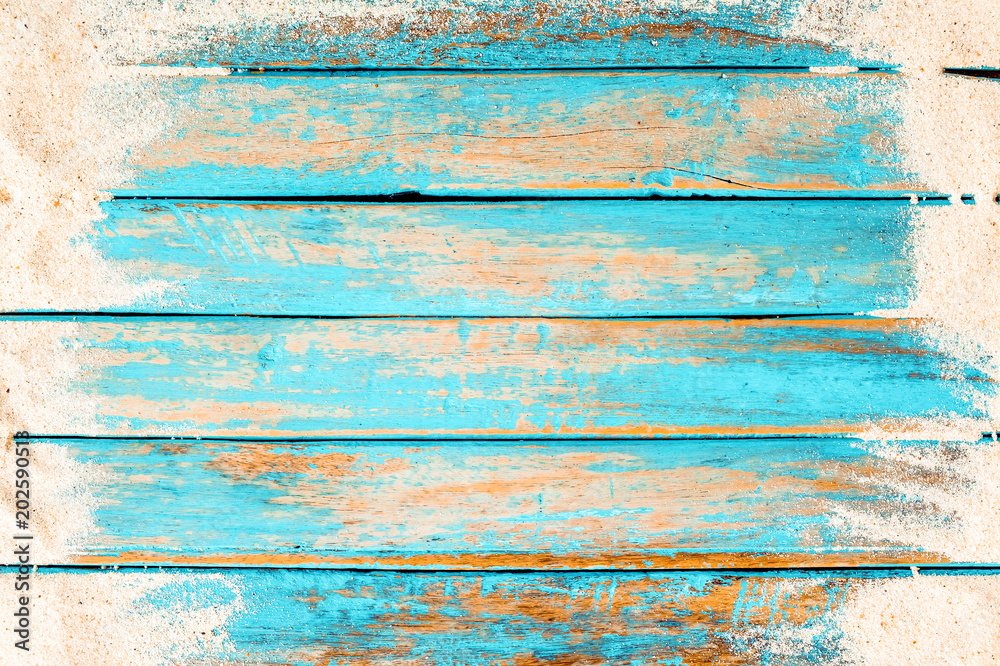 Fototapety, obrazy: Beach background - top view of beach sand on old wood plank in blue sea paint background. summer vacation concept. vintage color tone.