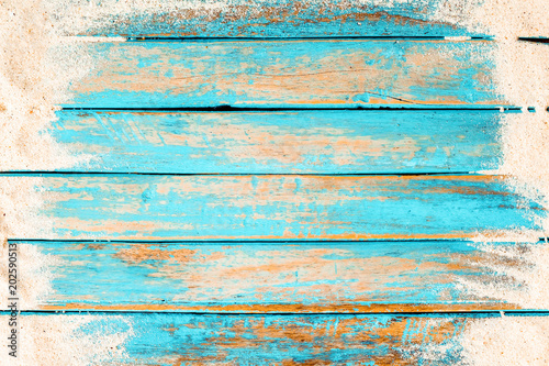 Beach background - top view of beach sand on old wood plank in blue sea paint background Tablou Canvas