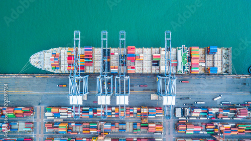 Fotografía  Aerial top view container cargo ship, Business import export logistic and transportation of International by containr cargo ship in the open sea