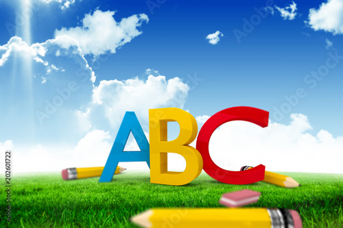 Plakat abecadło - alfabet abc-graphic-against-blue-sky-over-green-field