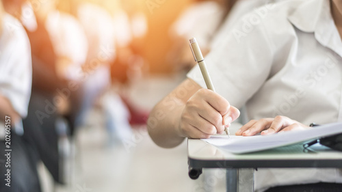 Fotografía  Exam withh school student having a educational test, thinking hard, writing answ