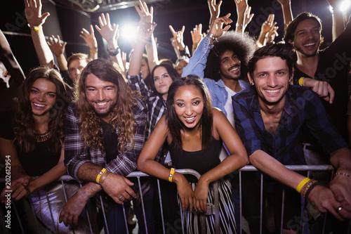Portrait of friends enjoying at music festival - 202612954