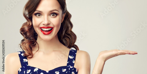 Woman surprise showing product Fototapeta