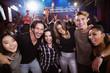 Portrait of cheerful friends enjoying at nightclub