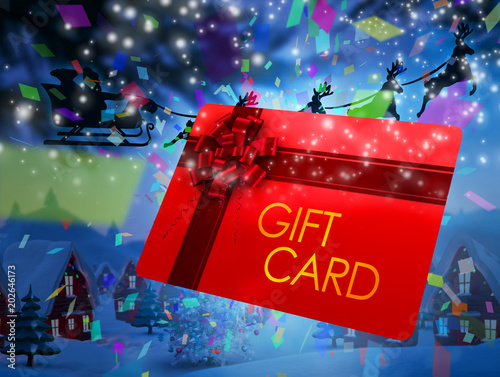 Poster Bordeaux Santa flying his sleigh behind gift card against cute christmas village with tree