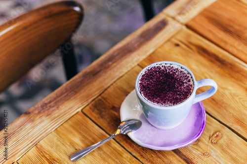 On latte on the table. Flat, top view. Wallpaper Mural