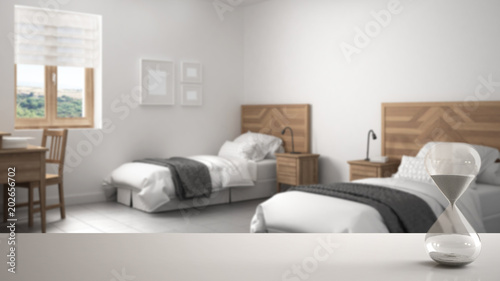White Table Or Shelf With Crystal Hourglass Measuring The Passing Time Over Blurred Modern Bedroom With Single Beds Architecture Interior Design Copy Space Background Buy This Stock Illustration And Explore Similar