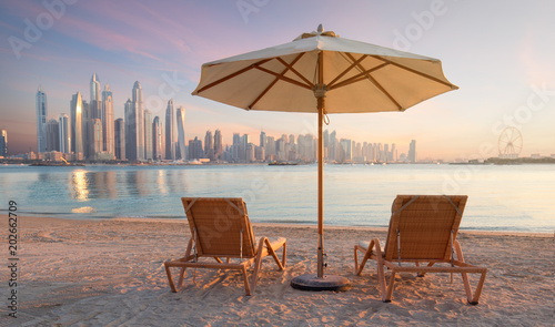 Foto op Aluminium Dubai Beautiful terrace with two chairs and an umbrella with Dubai Marina view