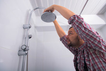 Workman Repairing Shower Head ...