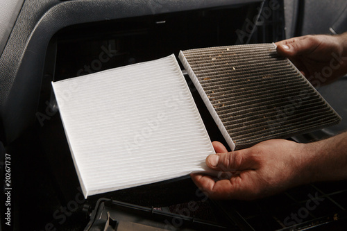 Fotografie, Obraz  replacing cabin air conditioner filter of car