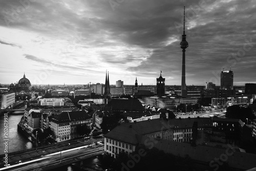 Illuminated landmarks in Berlin, Germany in the morning. Colorful cloudy sky at sunrise. Black and white