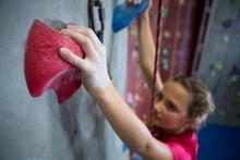 Determined Teenage Girl Practicing Rock Climbing