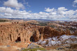 viewpoint of bryce canyon in utah in the spring time with snow on the ground and clear blue skies