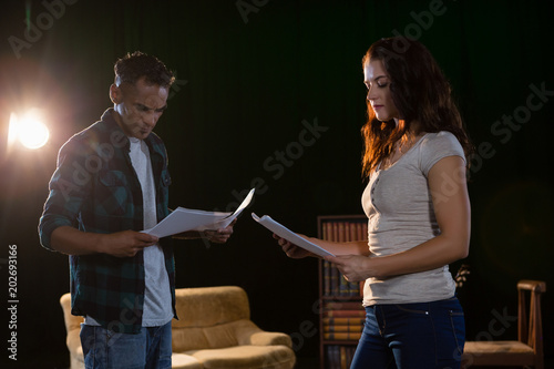 Fotografie, Tablou Actors reading their scripts on stage