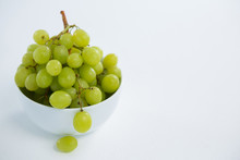 Close-up Of Green Bunch Of Grapes In Bowl