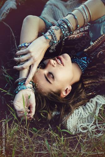 Poster Gypsy girl lying in grass