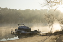 My Dock With Covered Boat And Jet Sky On A Foggy Morning Sunrise On A Lake In Georgia
