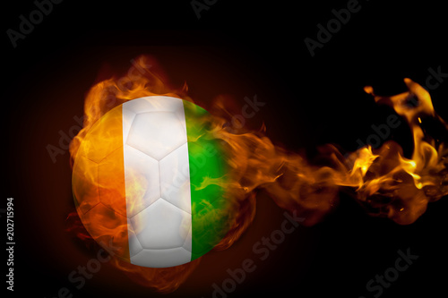 Composite image of fire surrounding ivory coast ball against black