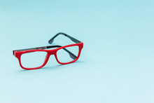 Black Red Eyeglasses On A Blue...