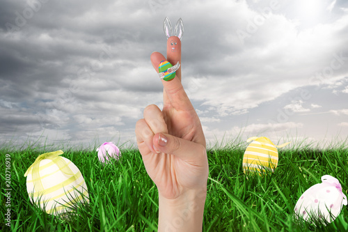 Fingers As Easter Bunny Against Green Hand Painted Easter Egg