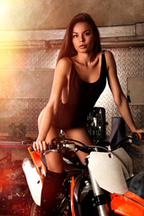 Fototapeta na wymiar Girl sitting on motorcycle