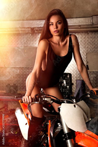 Girl sitting on motorcycle