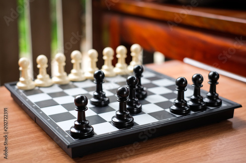 Valokuva  Chess black pawn invade (attack) white pawn for leader background or texture - Business & Strategy Concept