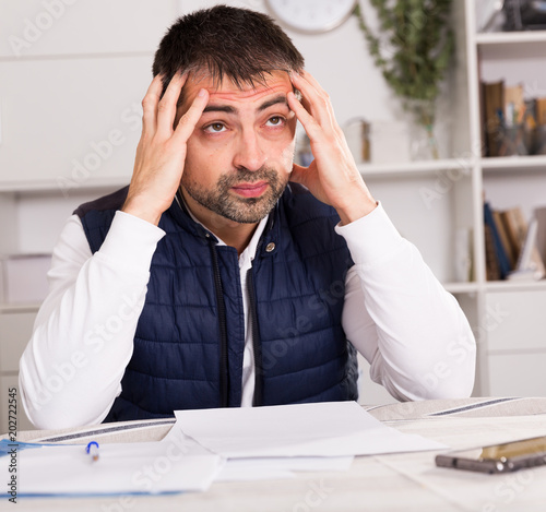 Distressed male having problems with paying utility bills Poster