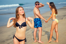 A Woman Scolds Her Man For Looking At Someone Else's Woman On The Beach (jealousy And Anger)