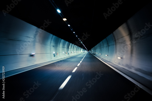 Tuinposter Tunnel car driving through tunnel