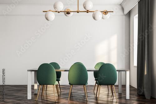 Fotografía  Minimalistic dining room interior, green chairs