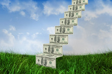 Steps Of Dollars Against Field Of Grass Under Blue Sky