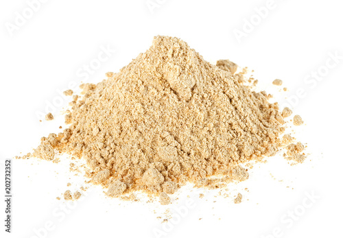 Tuinposter Kruiderij Heap of dried ginger powder isolated on white background