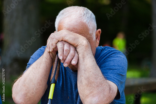 Fotografía  Sad, hunched old man