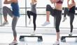 Women raising their legs while doing aerobics