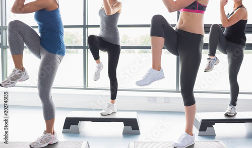 Fotografie, Obraz  Women raising their legs while doing aerobics