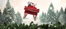 Santa Flying His Sleigh Against Christmas Scene